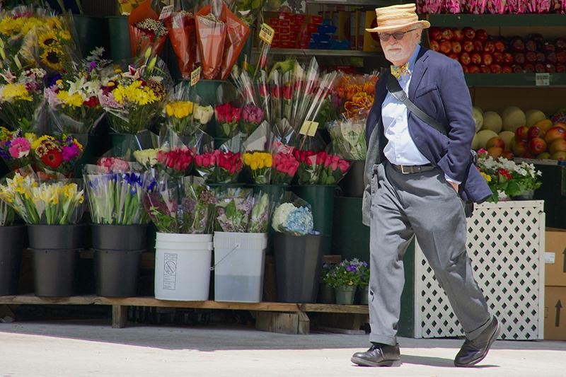 Man Walks By Flowers