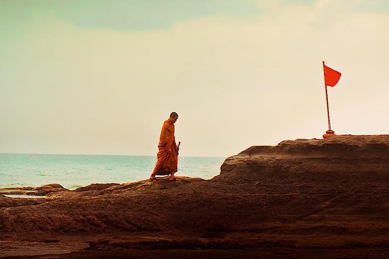 monk crusing across the rocks in Bali, looks like mini golf